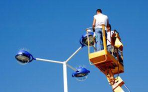 worker servicing pole lights